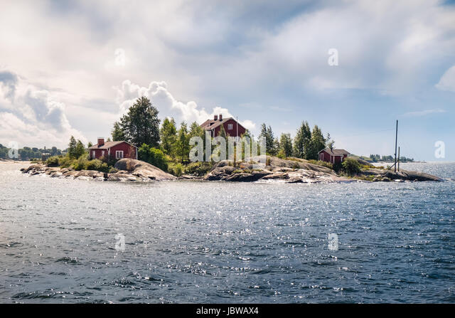Landscape with idyllic island and cottage at summer day in Finland - Stock Image
