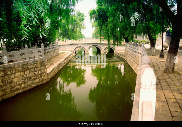 Bridge across a canal, Qufu, Shandong Province, China - Stock Image