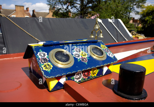 Colourful rooflight on the roof of a narrowboat, moored on the Trent and Mersey Canal, , decorated roof, light, - Stock Image