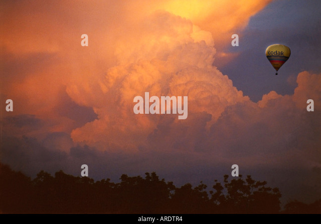 Hot Air Balloon and Storm Clouds sunset - Stock Image