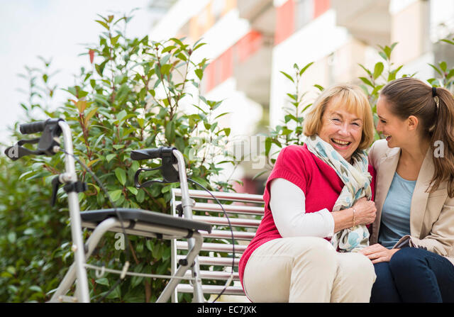 Granddaughter and her grandmother having fun together - Stock Image