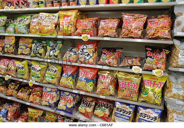 Tokyo Japan Ikebukuro FamilyMart Convenience Store business interior shopping kanji hiragana katakana characters - Stock Image