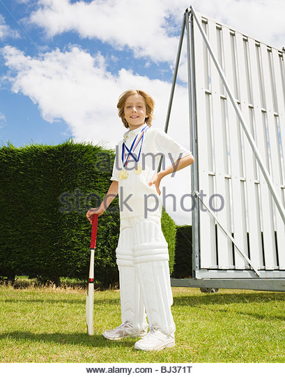 Boy with Cricket Bat and medals - Stock Image