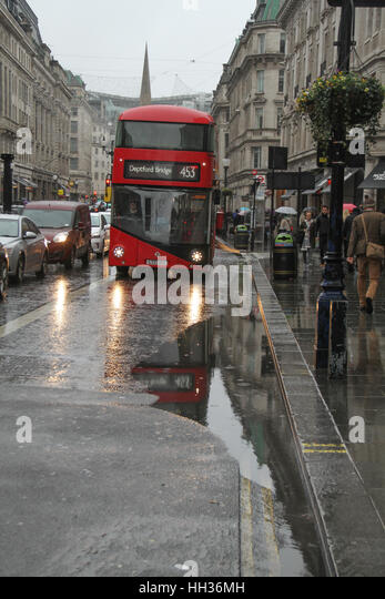 A London red bus seen on a semi flooded Regent Street  following a rain shower on.following a rain shower on January - Stock Image