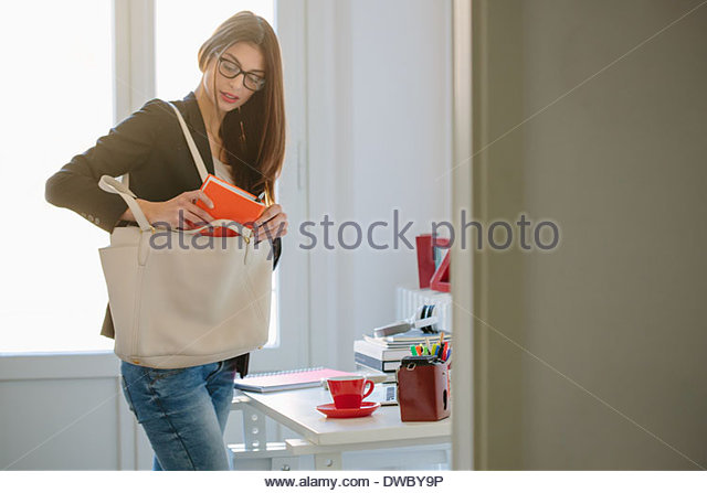 Young woman getting ready to go out - Stock Image