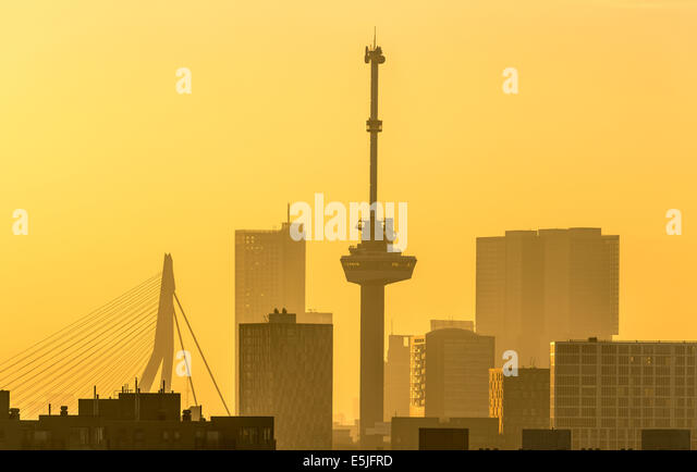 Netherlands, Rotterdam, Skyline with Euromast and Erasmus bridge. Sunrise - Stock Image