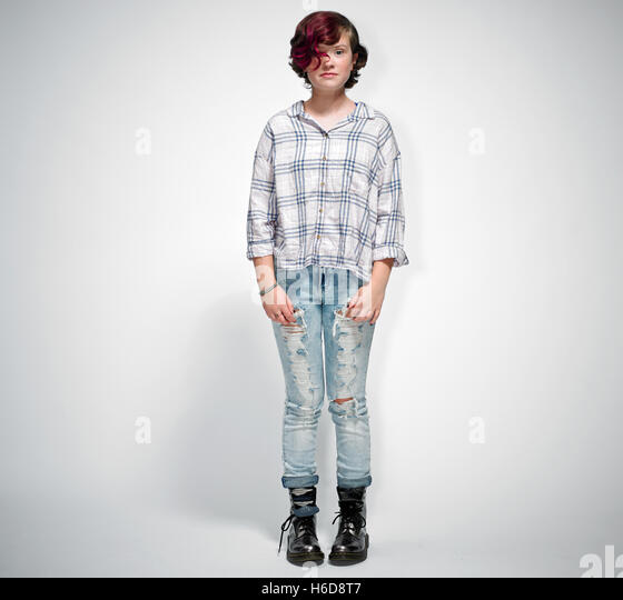 Portrait of tween girl in studio surprised, smiling full body on white sweep - Stock Image