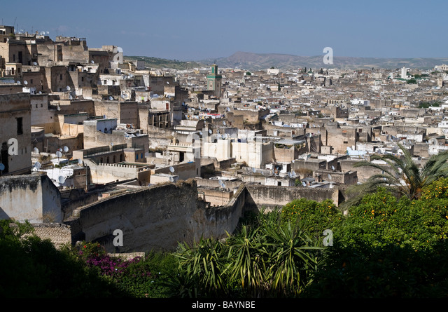 Stunning view over the rooftops of Fez medina from Riad Mokri - now a music school. Showing derbs, riads, and Kairaouine - Stock Image