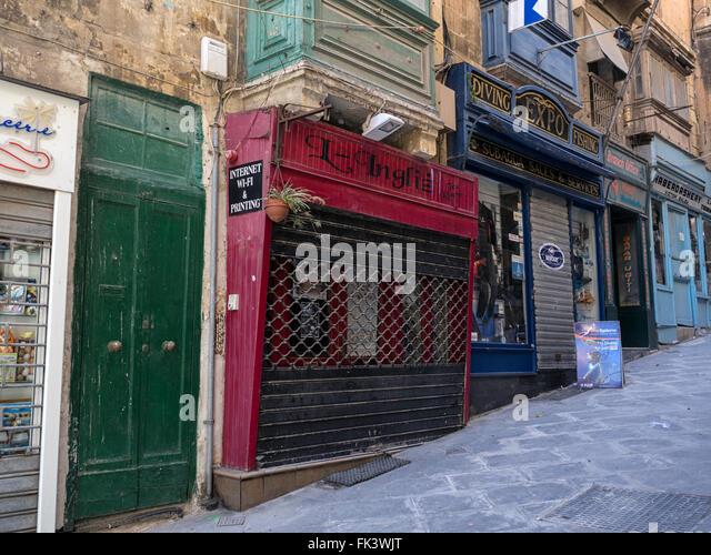 Steep street in Valletta, capital of the island state of Malta in the Mediterranean sea - Stock Image