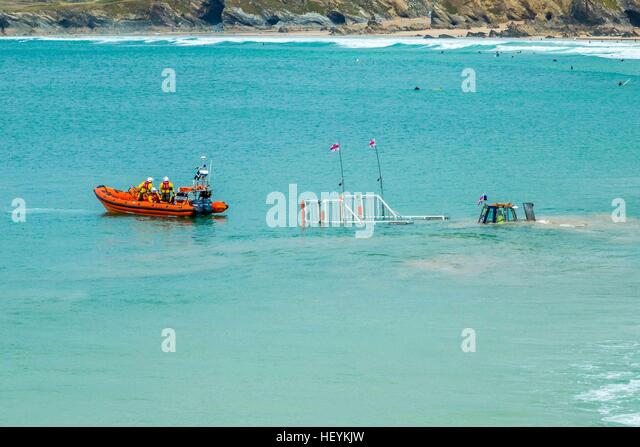 The Newquay RNLI life boat returning to the harbour in Cornwall on it;'s cradle - Stock Image