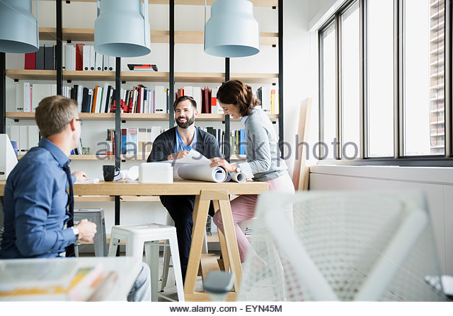 Architects working in office - Stock Image