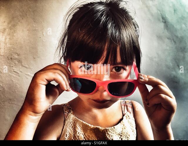Sad looking girl with sunglasses - Stock-Bilder