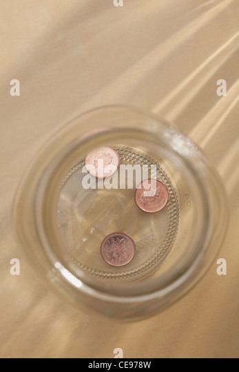 Studio shot of jar with coins - Stock Image
