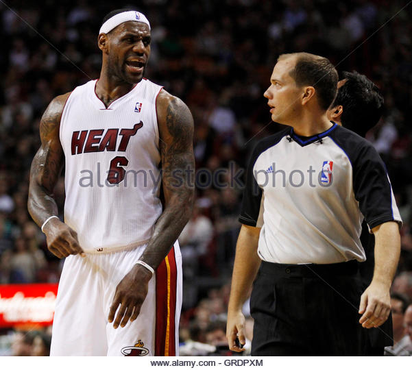 Miami Heat's LeBron James (L) complains to official John Goble after a call during the second quarter of their - Stock Image