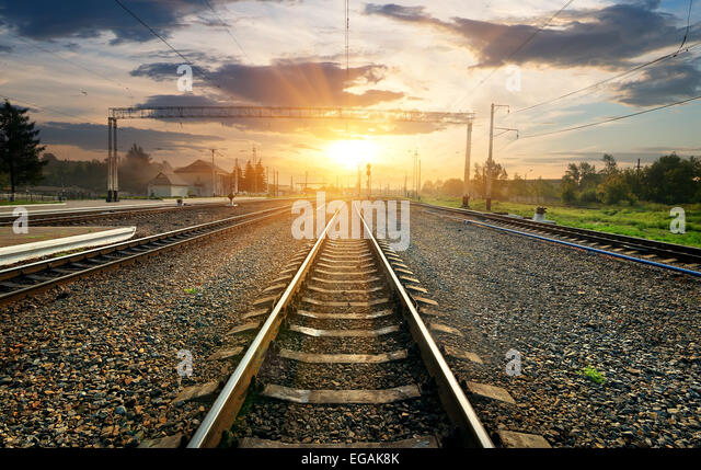 Railroad and small station at the sunset - Stock Image