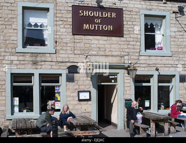 People sat outside the Shoulder of Mutton pub in Hebden Bridge, West Yorkshire, England, UK - Stock Image