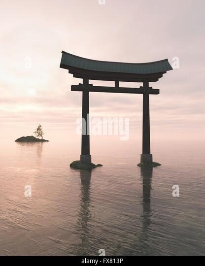 Japanese Floating Torii Gate at a Shinto Shrine, Evening - Stock Image