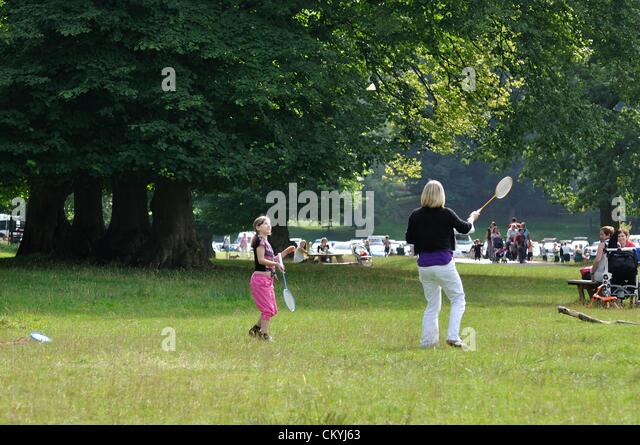 Monday 03/09/2012 Lyme Park, Cheshire. Woman and female child play badminton on warm, sunny day using yellow shuttlecock. - Stock Image