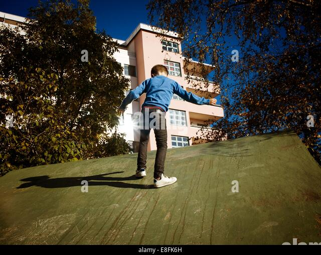 Norway, Oslo, Frogner, Marienlyst, Boy (8-9) playing in urban environment - Stock Image