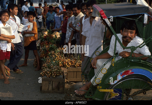 Indonesia Southeast Asia Bogor produce vendors bicycle taxi driver smiling males - Stock Image