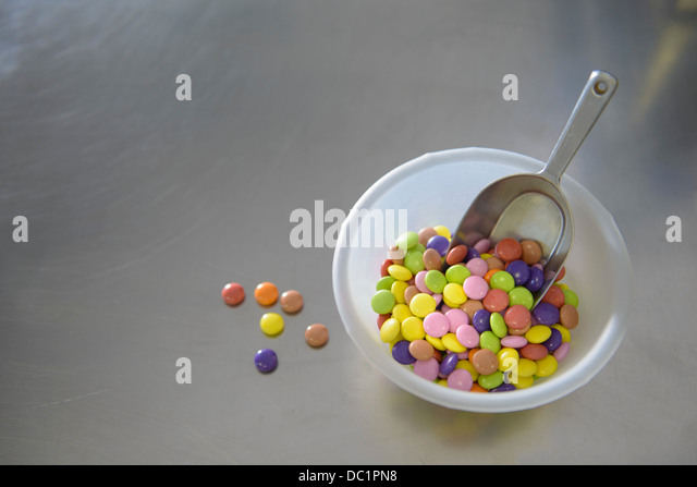 Still life bowl of multi colored sweets - Stock Image