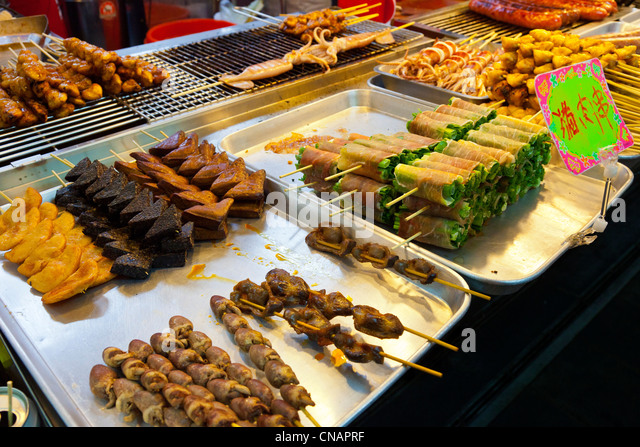 Food snacks on stall in Shilin Night Market Taipei Taiwan. JMH5991 - Stock Image