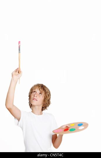 kid artist painting blank space - Stock Image