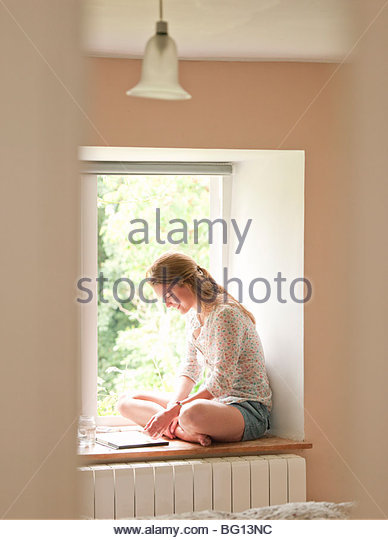 woman by window painting - Stock Image