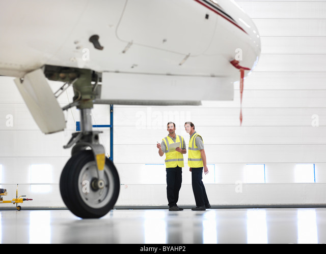 Engineers with jet aircraft wheel - Stock Image