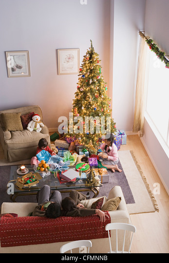 USA, California, Los Angeles, Family with two daughters (10-11) at Christmas morning - Stock Image