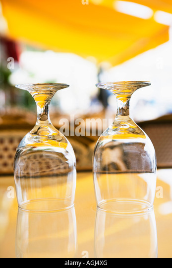 Close-up of two empty wine glasses on a table - Stock Image