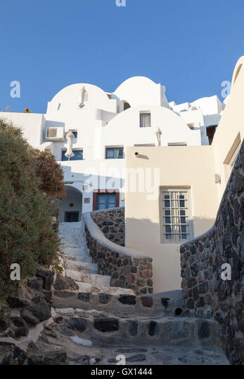 Homes nestled in the sloping cliffs of Imerovigli on the hot and beautiful Greek island of Santorini - Stock Image