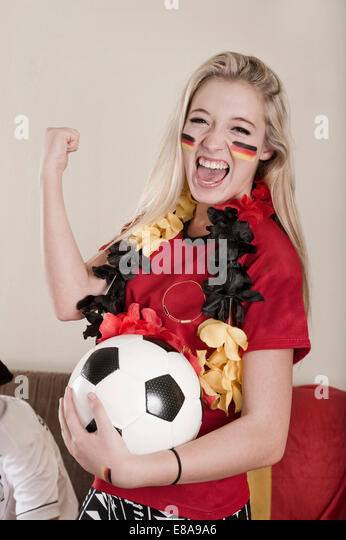 Portrait of female teenage soccer fan - Stock Image