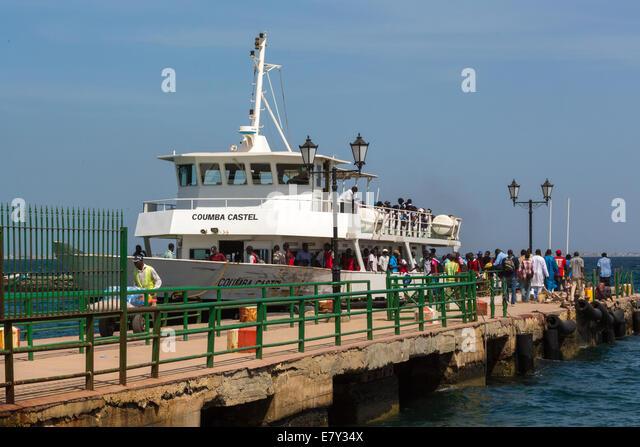 Columbia Castel, the ferry to Gorée Island, unloads its passengers arriving form Dakar, Senegal - Stock Image