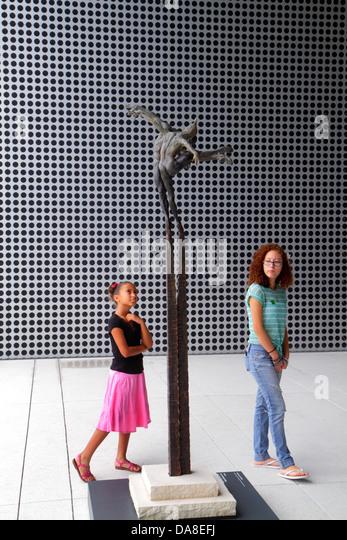 Tampa Florida Tampa Museum of Art sculpture Black girl teen tween looking appreciating sisters siblings - Stock Image