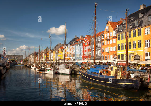 Copenhagen Nyhavn Canal - The famous colourful houses line - Stock Image