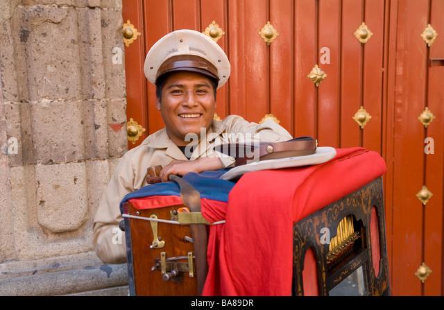 Street muscian playing harmonipan Mexico City, Mexico - Stock Image