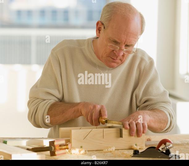 Senior man woodworking - Stock Image