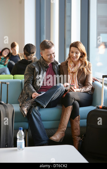 Mature couple in departure lounge - Stock Image
