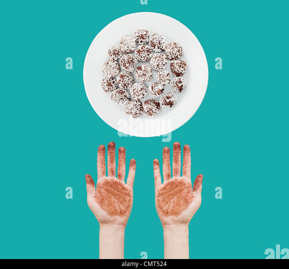 Messy hands and chocolate balls - Stock-Bilder