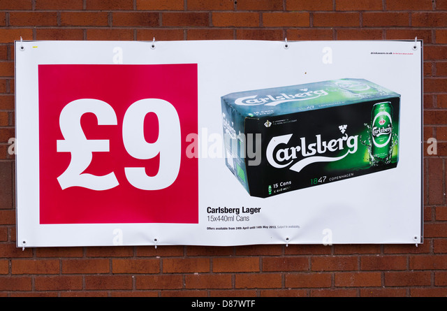 Cheap lager poster on a Co-op supermarket, UK - Stock Image