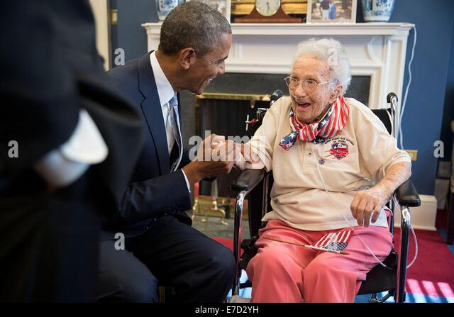 US President Barack Obama visits with Lucy Coffey in the Vice President's Office of the White House July 25, - Stock Image