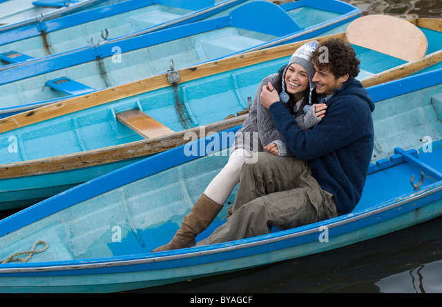 Man and woman in row boat - Stock Image