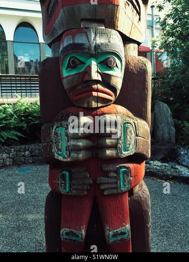 Fragment of Totem pole at the Royal BC museum's courtyard in Victoria, Canada - Stock Image