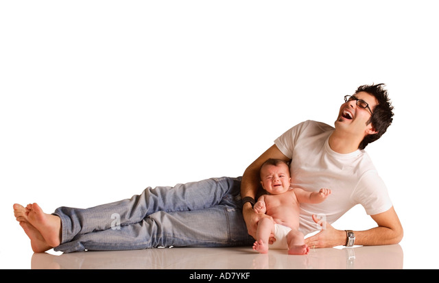 Laughing dad with baby - Stock Image