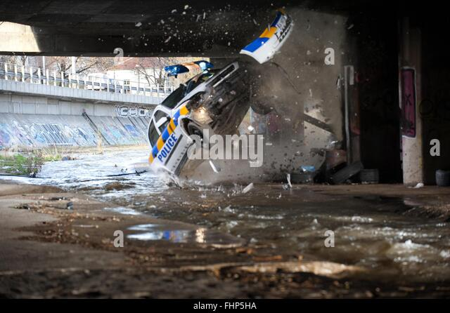 POLICE CAR CRASH SCENE GETAWAY (2013) - Stock Image