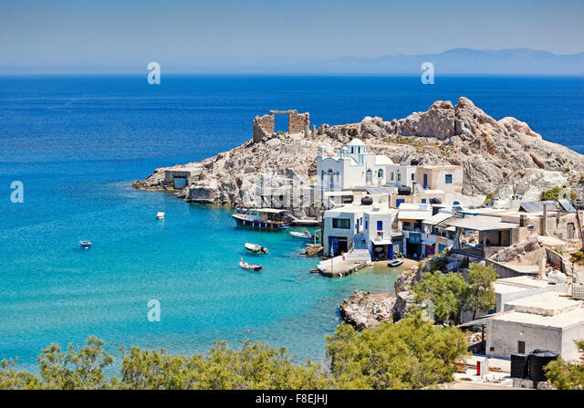 "Traditional fishermen houses with the impressive boat shelters, also known as ""syrmata"" in Firopotamos of Milos, - Stock Image"