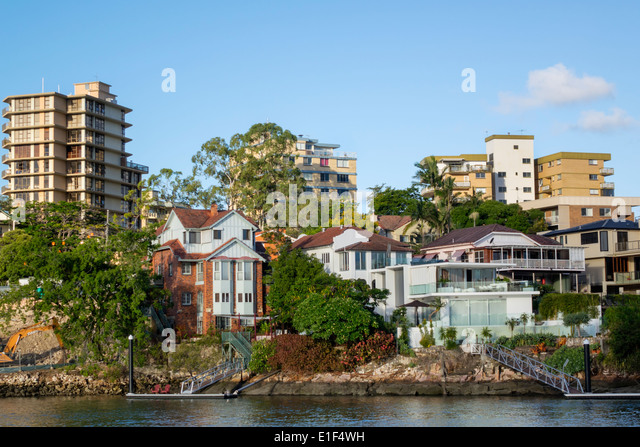 Brisbane Australia Queensland Brisbane River New Farm apartment buildings houses residences waterfront - Stock Image