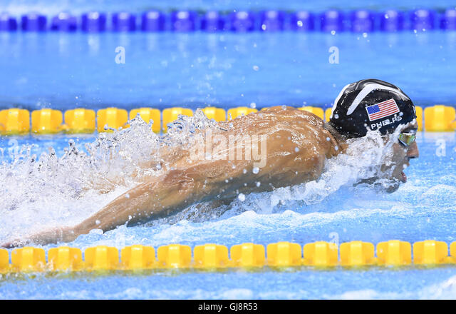 Rio De Janeiro, Brazil. 13th Aug, 2016. Michael Phelps of the United States competes during the men's 4x100m - Stock-Bilder