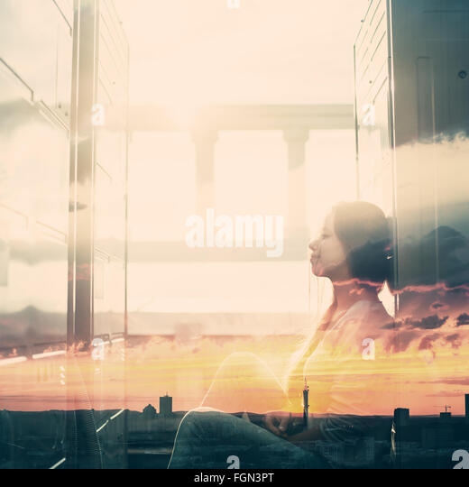 Abstract Portrait of Young Woman with Double Exposure Effect. Combined with Sunset Sky, Toned with Vintage Instagram - Stock-Bilder